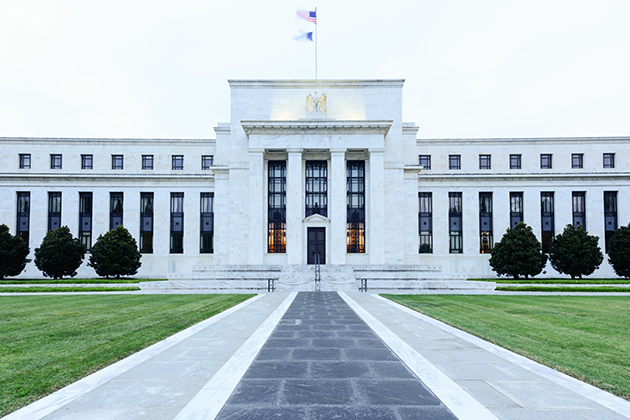 What does the Fed's interest rate cut mean for businesses, workers?