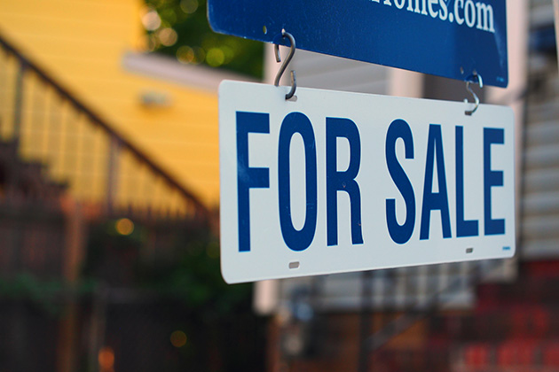 Mixed signals keep housing market in check