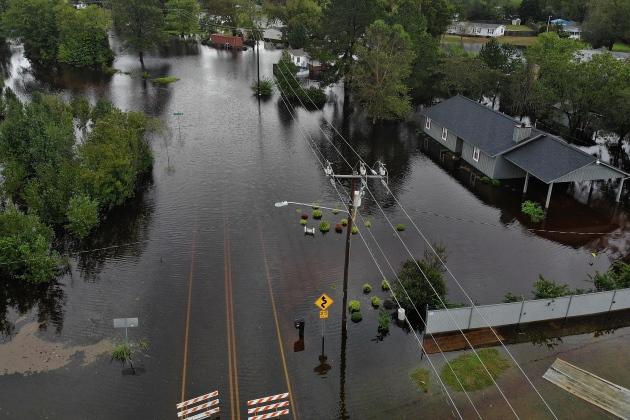 Florence lands in Carolinas, killing 23 people